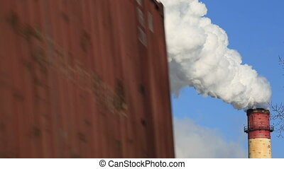 Freight transport on background of industrial smoke from the...
