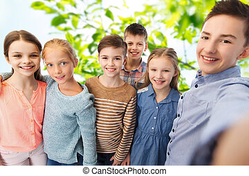 happy children talking selfie - childhood, friendship,...