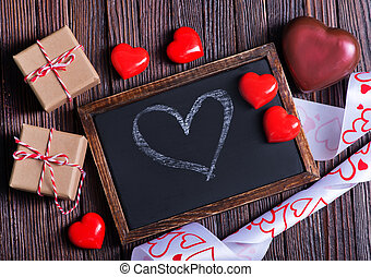 red hearts and black board on a table