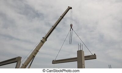 Mobile crane is operating and lifting