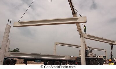 Crane is unloading concrete joist - Concrete truss is...