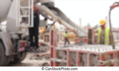 Blurred view at pouring concrete in