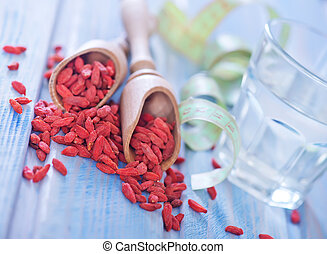 Goji - dry goji berries on the wooden table