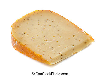 Gouda cheese with caraway in front of white background