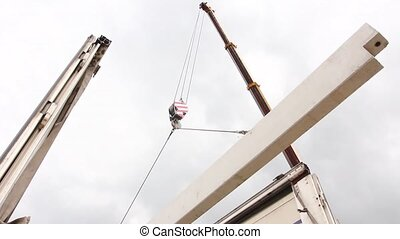 Mobile crane is unloading concrete - Mobile crane is carry...