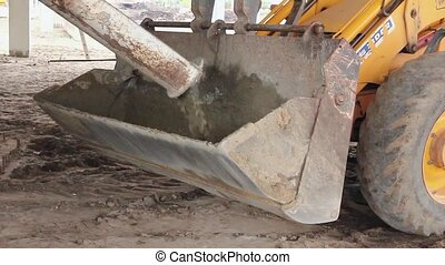 Concrete transport. - Truck mixer is pouring concrete into...