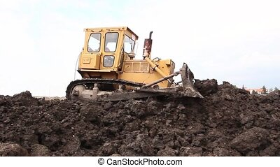 Bulldozer machine is leveling const - Earthmover with...