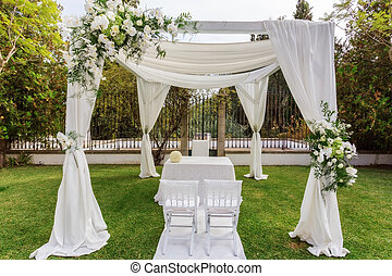 Archway for wedding with a table for the newlyweds ..