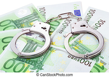 steel handcuffs on a heap of 100 euro banknotes