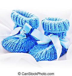 baby booties - Handmade baby booties isolated on a white...