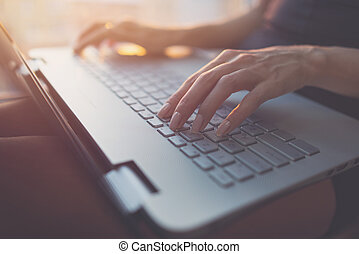 Woman working at home office hand on keyboard close up.