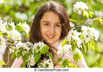 Middle East teenager girl with white pear flowers - Middle...