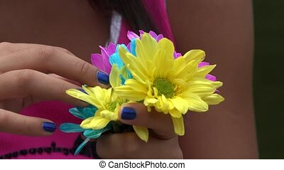 Girl Holding Colorful Flowers