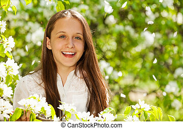 Portrait of laughing girl with white pear flowers - Portrait...