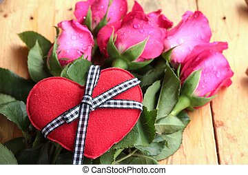 Rose with red hearts for Valentine's Day.