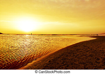 sunset at Lances Beach in Tarifa, Spain - a view of the...