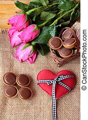 Chocolate and red hearts for valentines day.