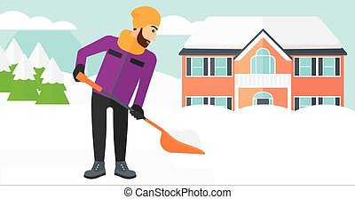 Man shoveling and removing snow. - A hipster man with the...