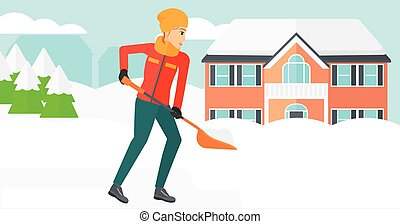 Woman shoveling and removing snow - A woman shoveling and...