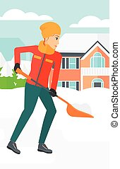 Woman shoveling and removing snow. - A woman shoveling and...