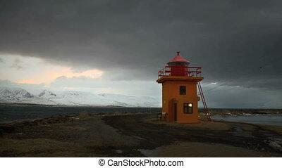 Time lapse of orange lighthouse