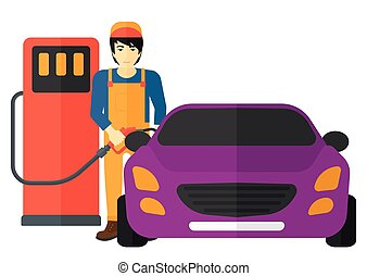 Man filling up fuel into car - An asian man filling up fuel...