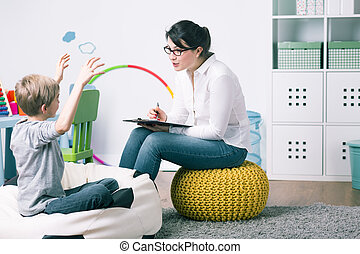 Learning can be real fun! - Boy and young woman teacher...