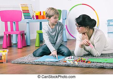 Play and learn, this is fun! - Private teacher and small boy...