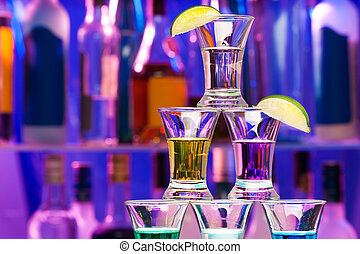 Closeup of shot pyramid  glasses with limes