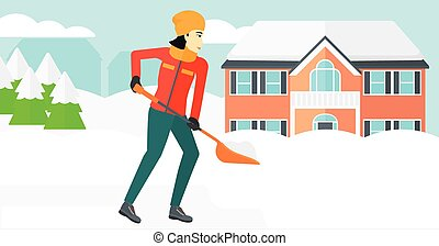 Woman shoveling and removing snow. - An asian woman...