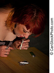Young woman snorting cocaine or heroin