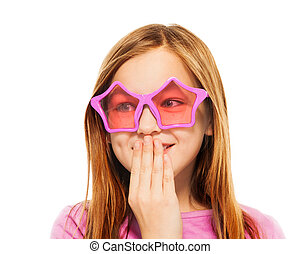 Funny giggling girl in glasses with star frames