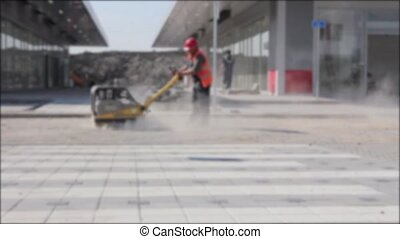Blurred view on worker who controls - Worker is working with...
