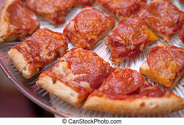 pizza bites - one pepperoni pizza sliced into small bite...