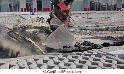 Bulldozer with bucket removes broke - Small excavator...