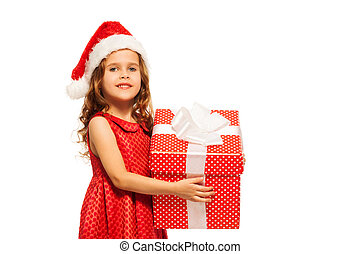 Close portrait of girl in Santa hat hold present - Nice...