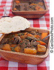 roast beef - two bowls of homemade beef stew with carrots...