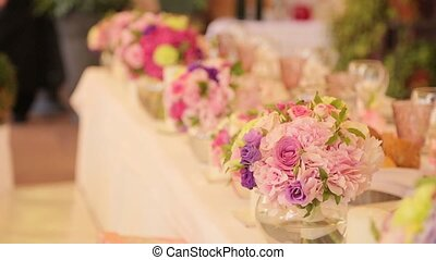 Festive wedding table with flowers