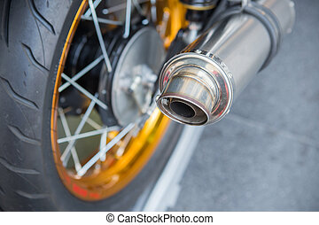 motor - Selective focus big chromed exhaust on motorcycle,...
