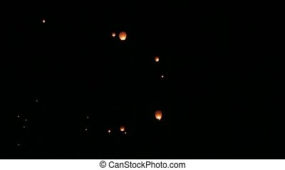 Many Chinese lanterns in the night sky