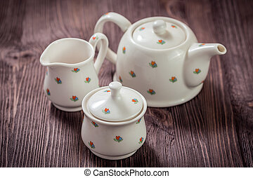 Porcelain tea set - White ceramic teapot, creamer and sugar...
