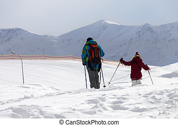 Father and daughter on ski resort after snowfall Caucasus...