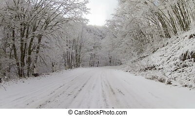 winter road after snowfall, Go Pro - scenic drive along the...