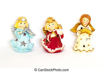 Figurines of angel on white background