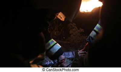 Rescuers work on the subject of fire at night
