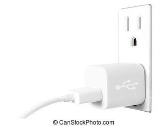 White electrical usb cord and charger plug in wall outlet -...