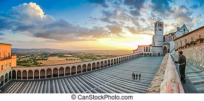 Basilica of St Francis of Assisi at sunset, Assisi, Umbria,...