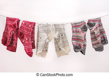 Various colored socks on a wire - Various colored socks...