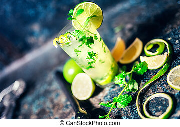 mojito cocktail details with lime garnish and bar details