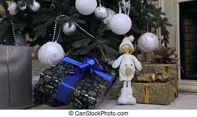 Gifts and Toys Under the Christmas Tree - Colorful gift...